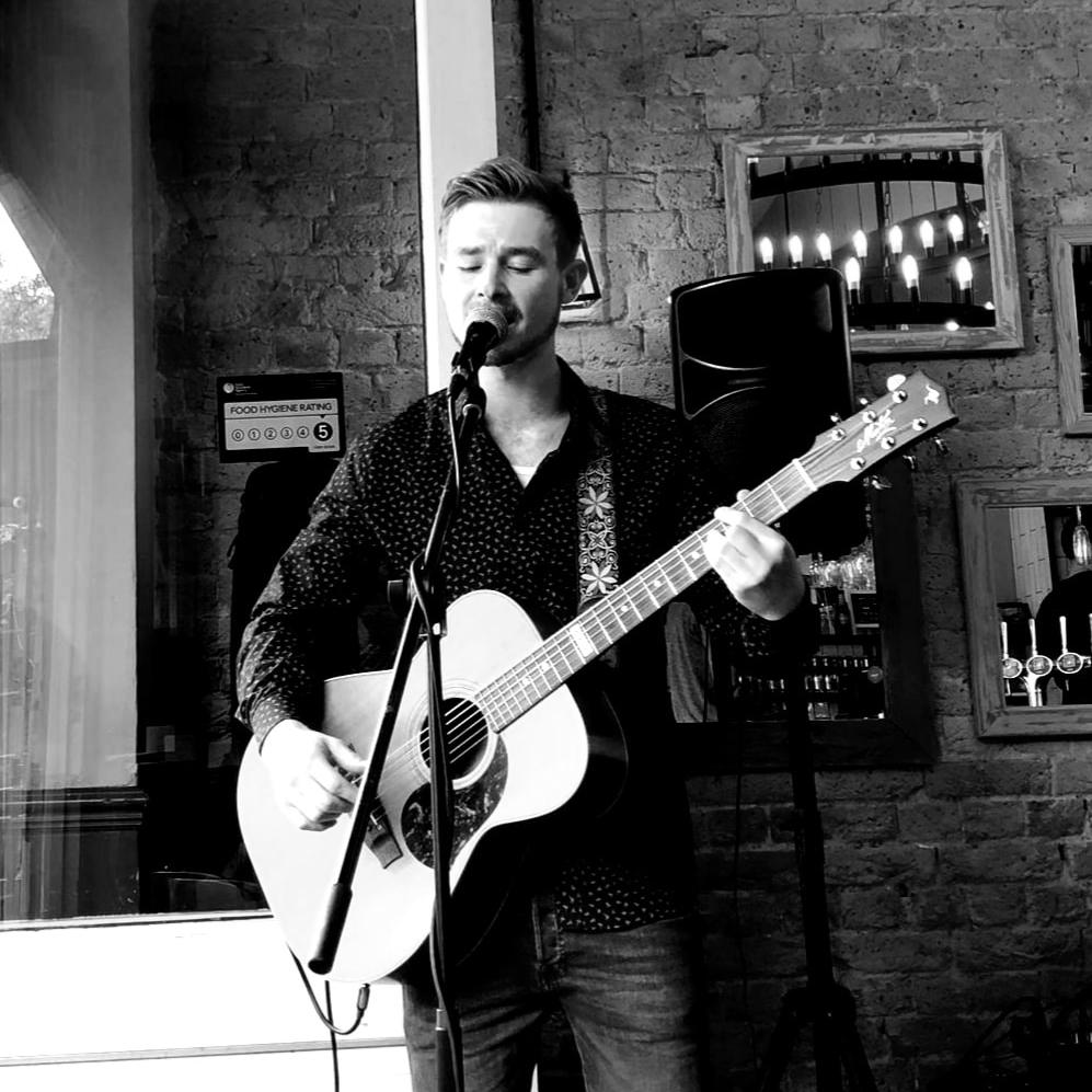 Callum Gardner Singing & Playing His Guitar - Musician Photo- Live Music at Key West Bar & Grill